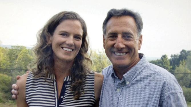 In this summer 2015 photo released by the Vermont Governor's Office, Gov. Peter Shumlin and his fiancee Katie Hunt pose for a photograph in Burlington, Vt. The governor's office said Thursday, Sept. 17, 2015, that Shumlin, 59, and Hunt, 31, were recently engaged and plan to marry within the next year, although they have not chosen a specific date. (Vermont Governor's Office via AP) MANDATORY CREDIT
