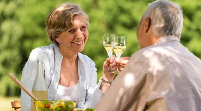 Happy senior citizens clinking glasses